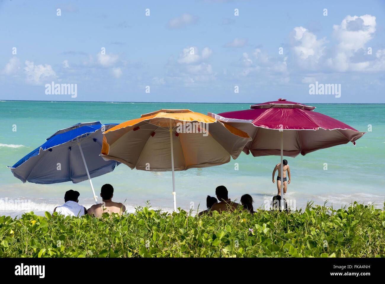 Umbrellas and sunbathers on the beach Antunes - Stock Image