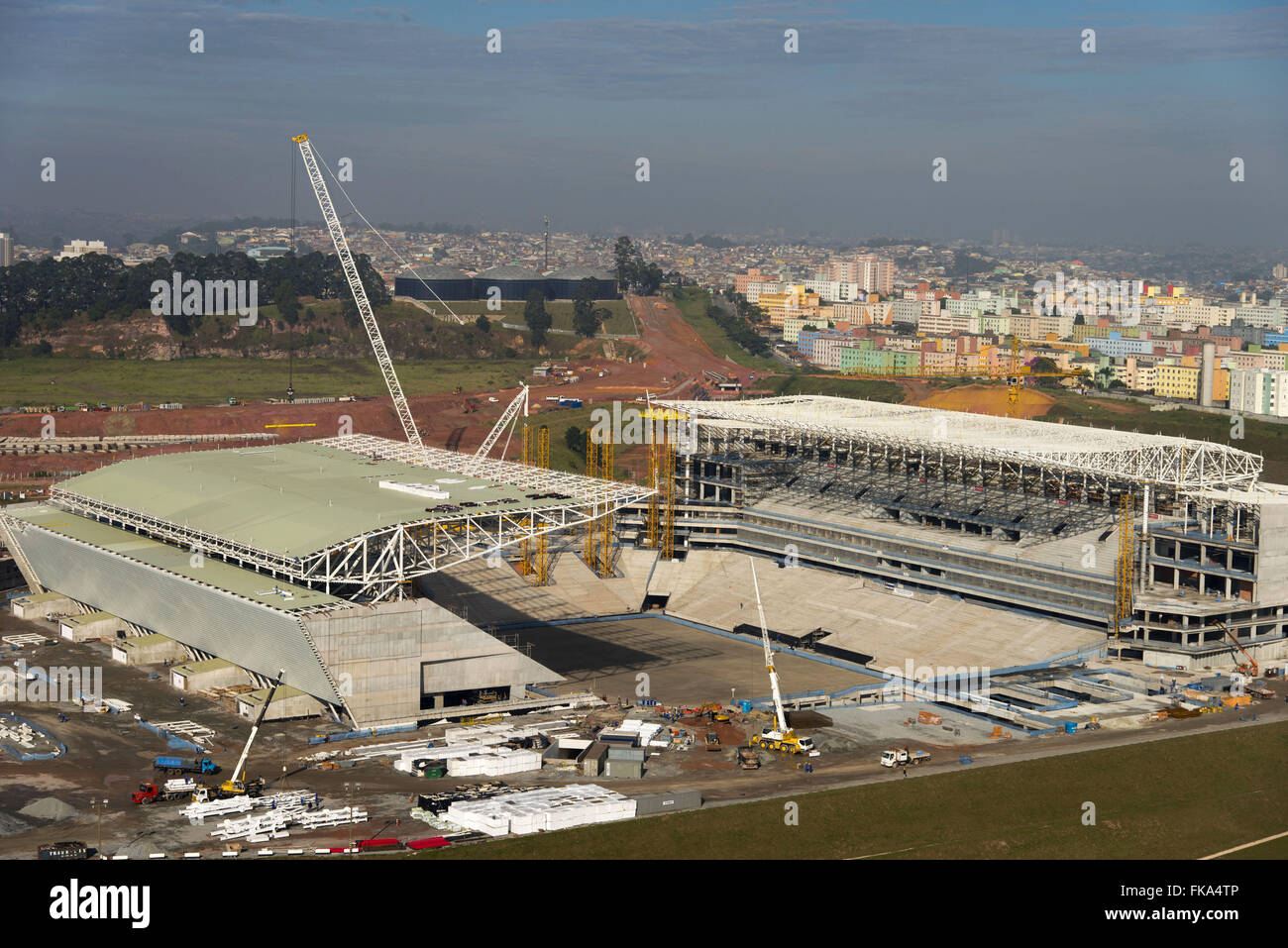 Aerial view of the construction work of the Corinthians stadium Arena with housing right - Stock Image