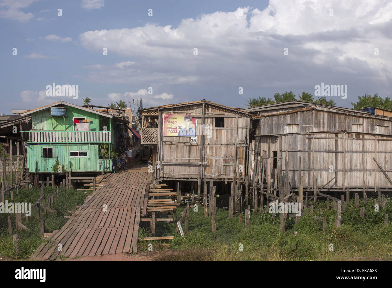 Remaining stilts Village Luzia after the urbanization of Range River waterfront - Stock Image