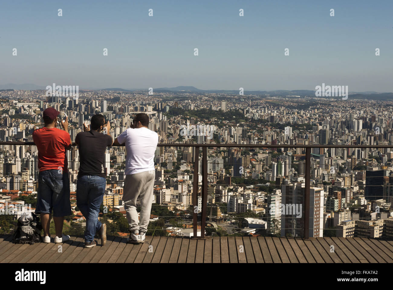 People contemplating the view of the city from Lookout Mangabeiras - Stock Image