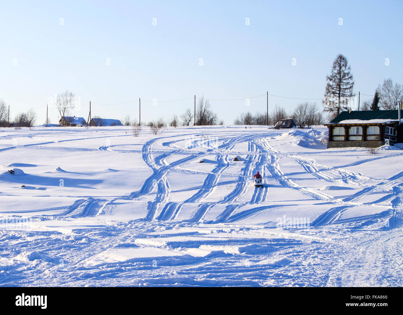 village landscape in the winter on a grief,a landscape, a snowmobile, a winter season, at home, descent, Russia, - Stock Image