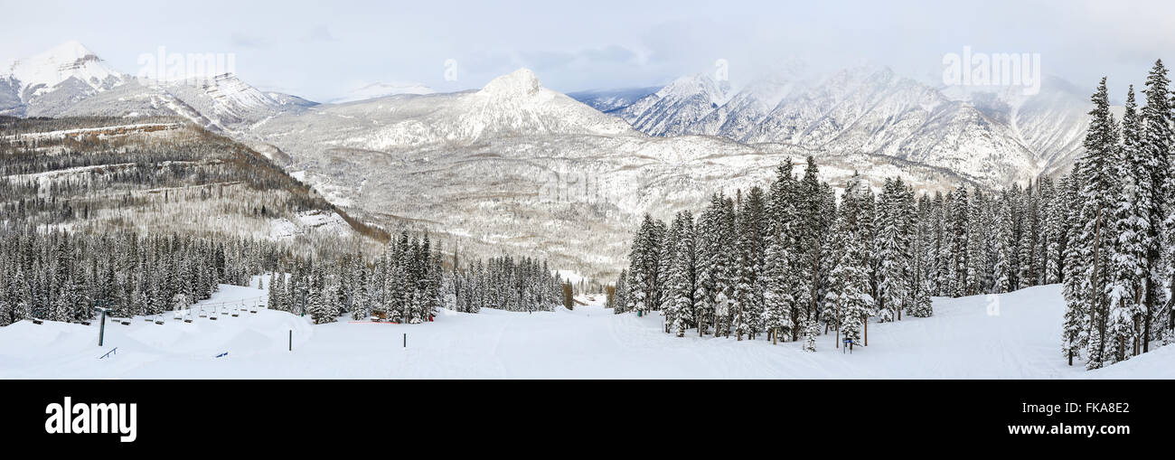 A panoramic view of a ski run at Purgatory Ski Resort, with the Needles mountains in the San Juan National Forest - Stock Image