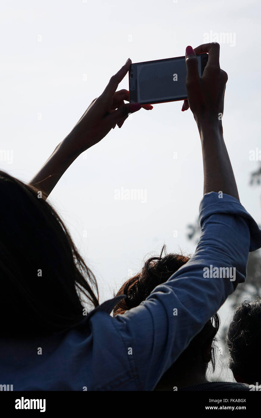 Youngster indulging in selfie-clicking - Stock Image