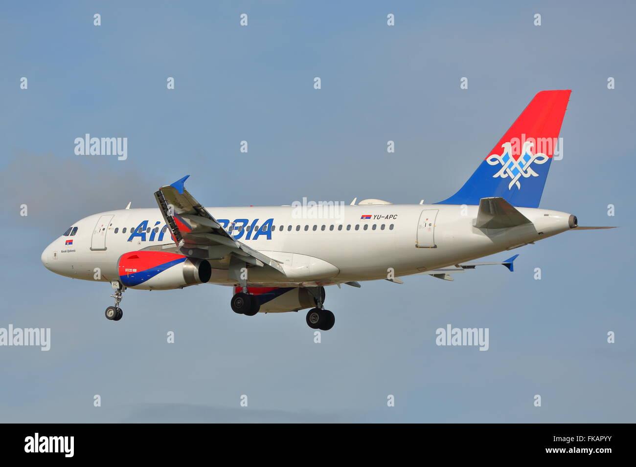 Air Serbia Airbus A319 YU-APC landing at London Heathrow Airport - Stock Image