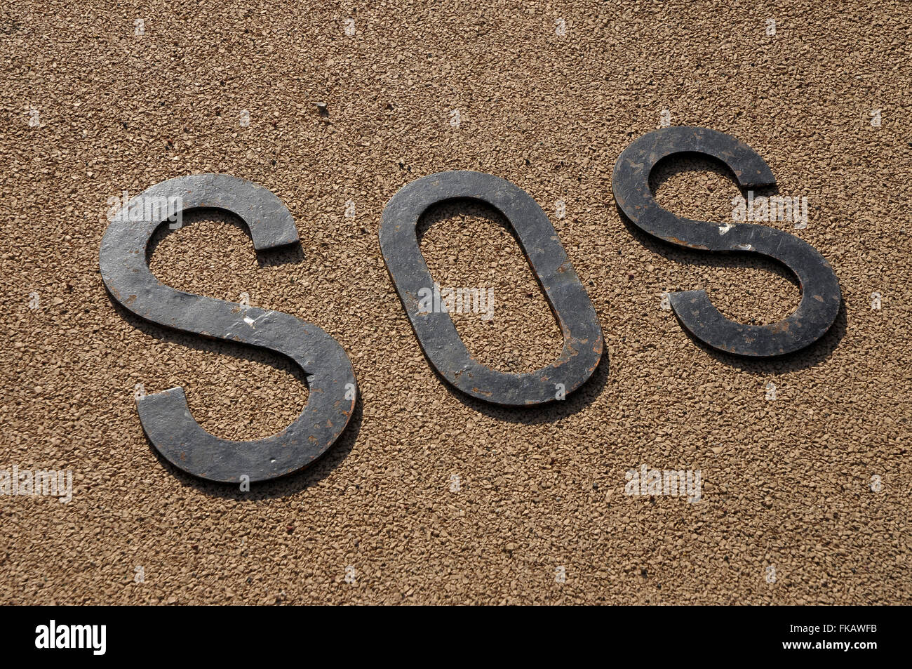 METAL. iron. letters, SOS, help, help, iron, icon help, salvation, symbol, global symbol, emergency, rescue, assistance, - Stock Image