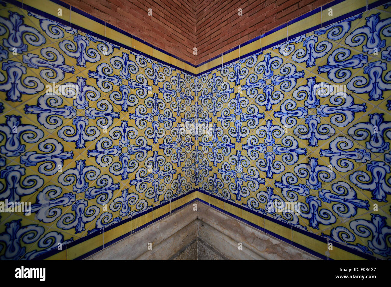 Spanish wall tiles yellow white and blue - Stock Image