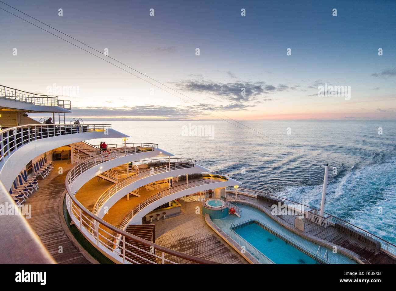 The aft (rear) open deck of P&O cruise ship Oriana in the North Sea, showing the heated Terrace Pool and surrounding Stock Photo