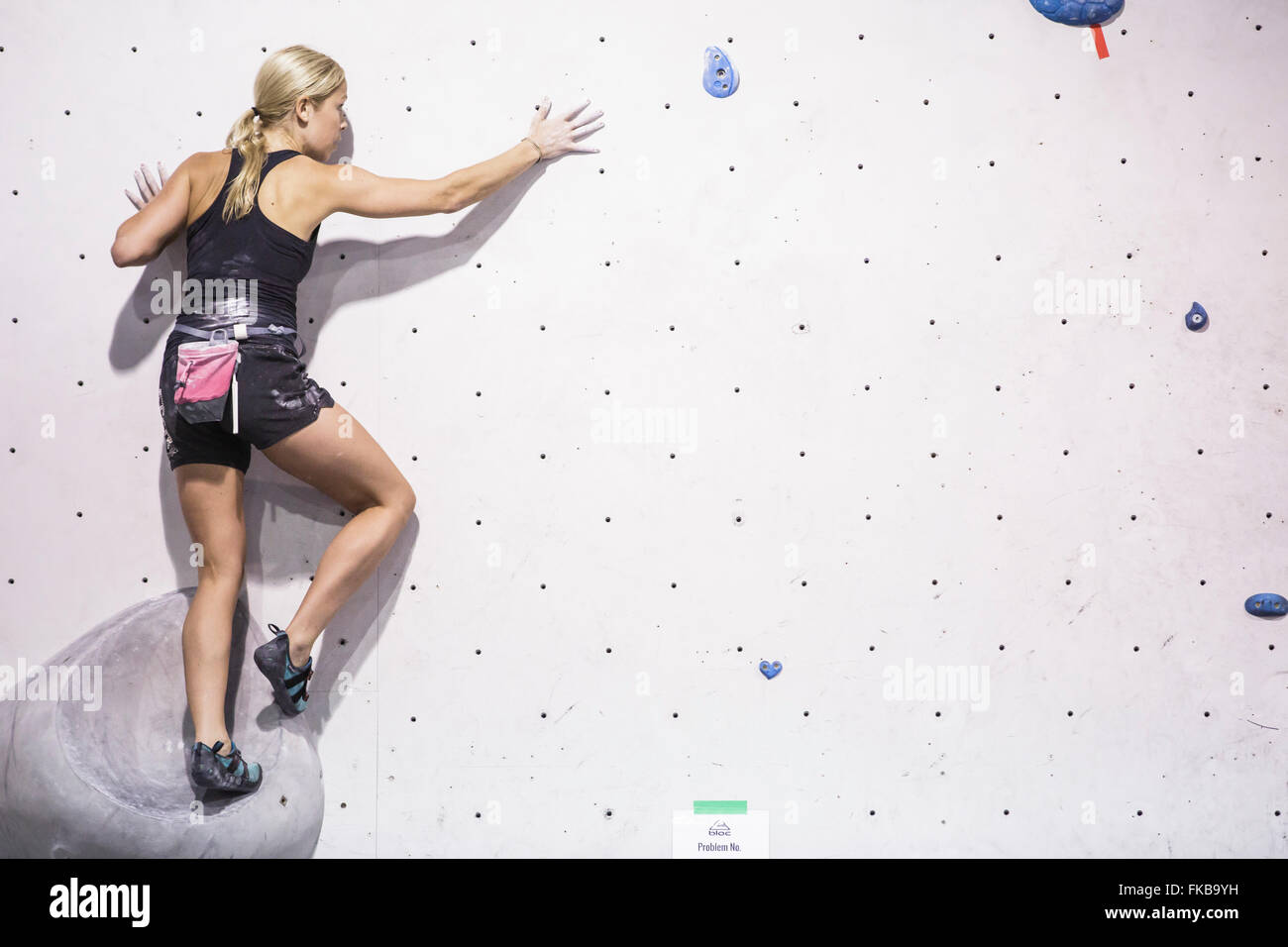 Climbers take part in a bouldering competition at Bloc climbing centre, Bristol. - Stock Image