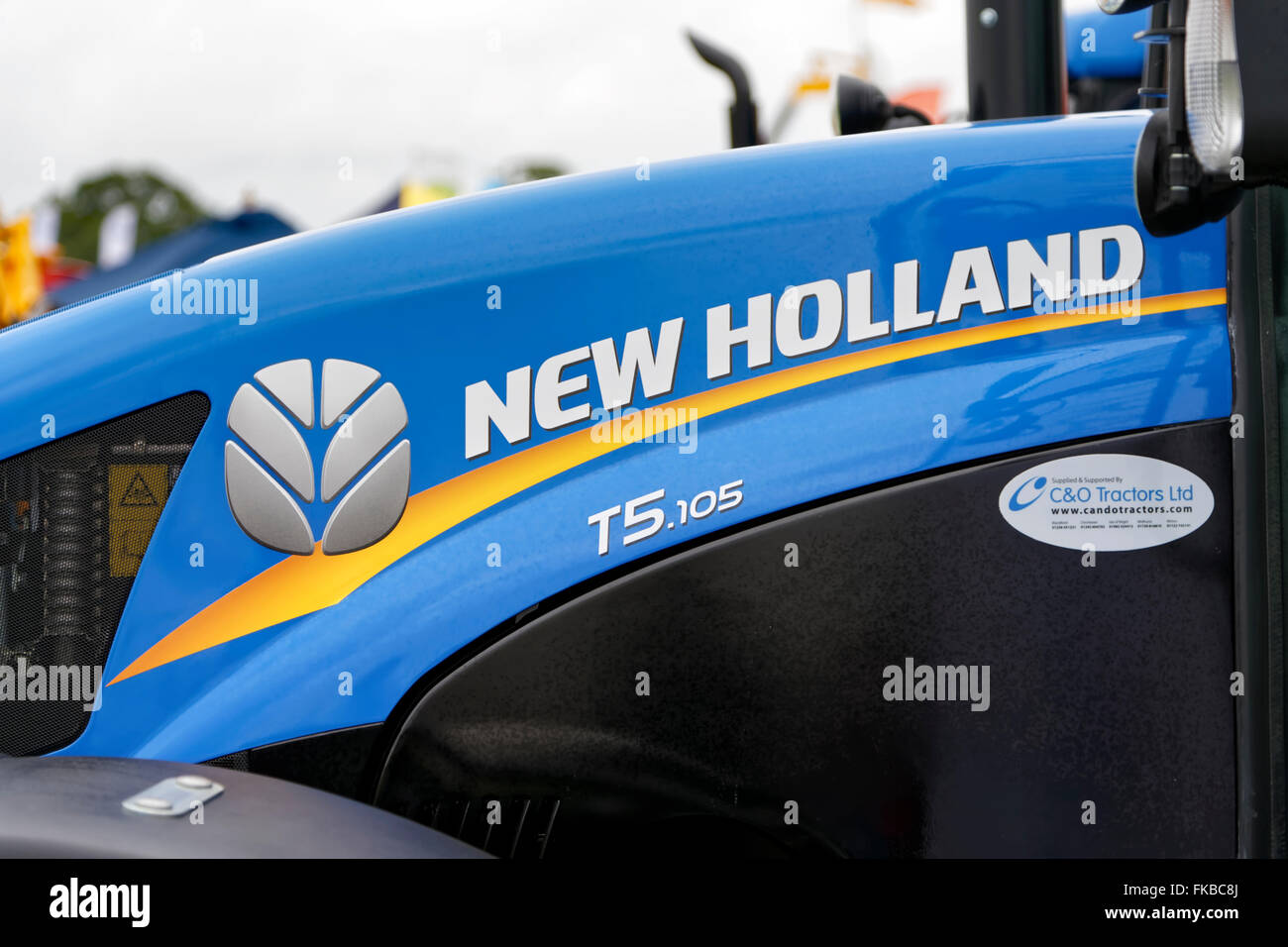 A brand new New Holland T5.105 Farm Tractor on sale at the 2015 Gillingham & Shaftesbury Agricultural Show, - Stock Image