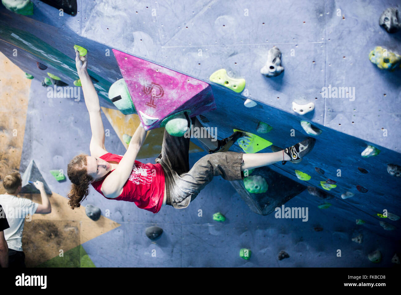 Climbers take part in a bouldering competition at The Climbing Academy, Bristol. - Stock Image