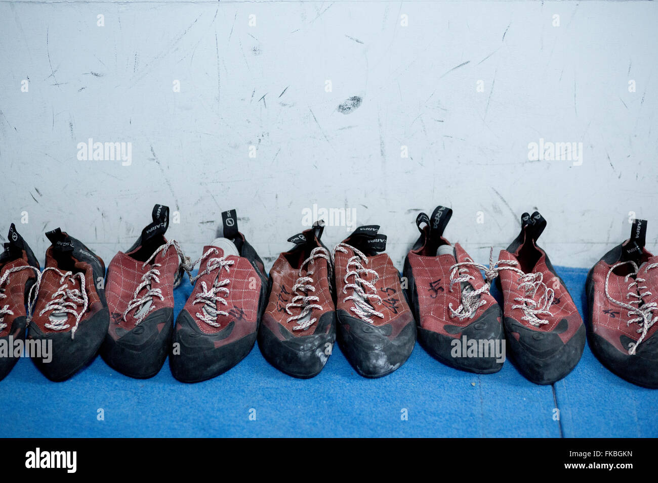 A row of climbing shoes a bouldering competition at The Climbing Academy, Bristol. - Stock Image