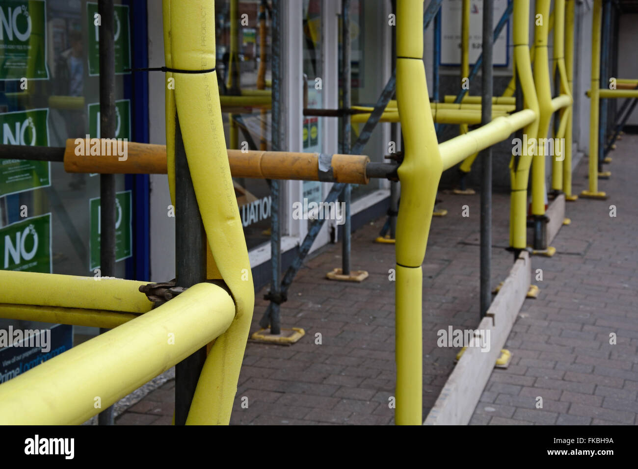 scaffolding with padding for safety. Beeston Nottingham. - Stock Image