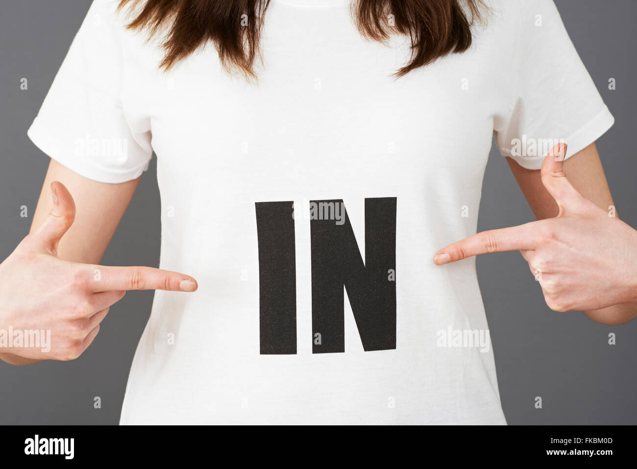 Woman Supporter Wearing T Shirt Printed With IN Slogan - Stock Image