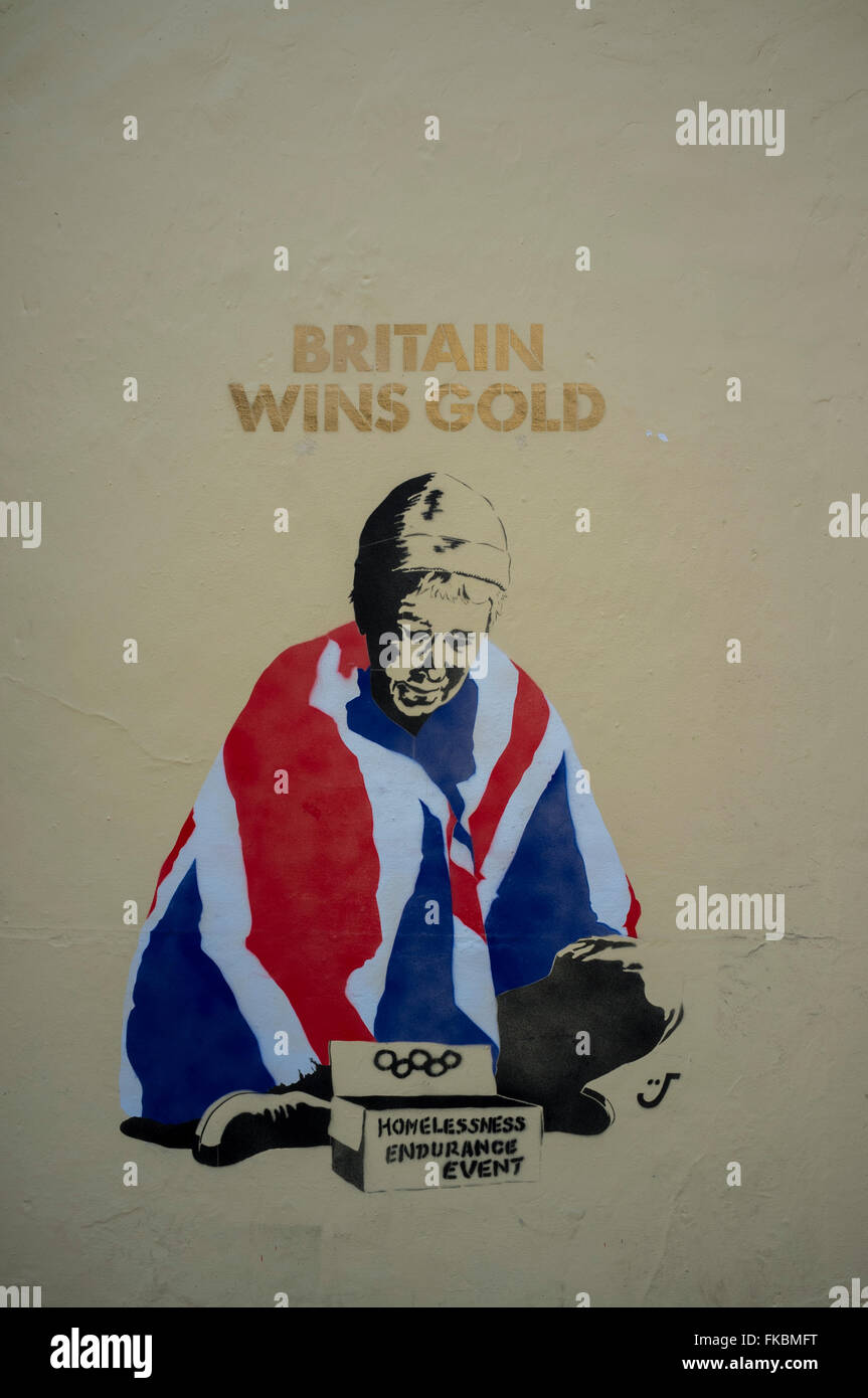 Stencil graffiti street art - Britain Wins Gold Homeless Endurance Event on a wall in Norwich, Norfolk, England, - Stock Image