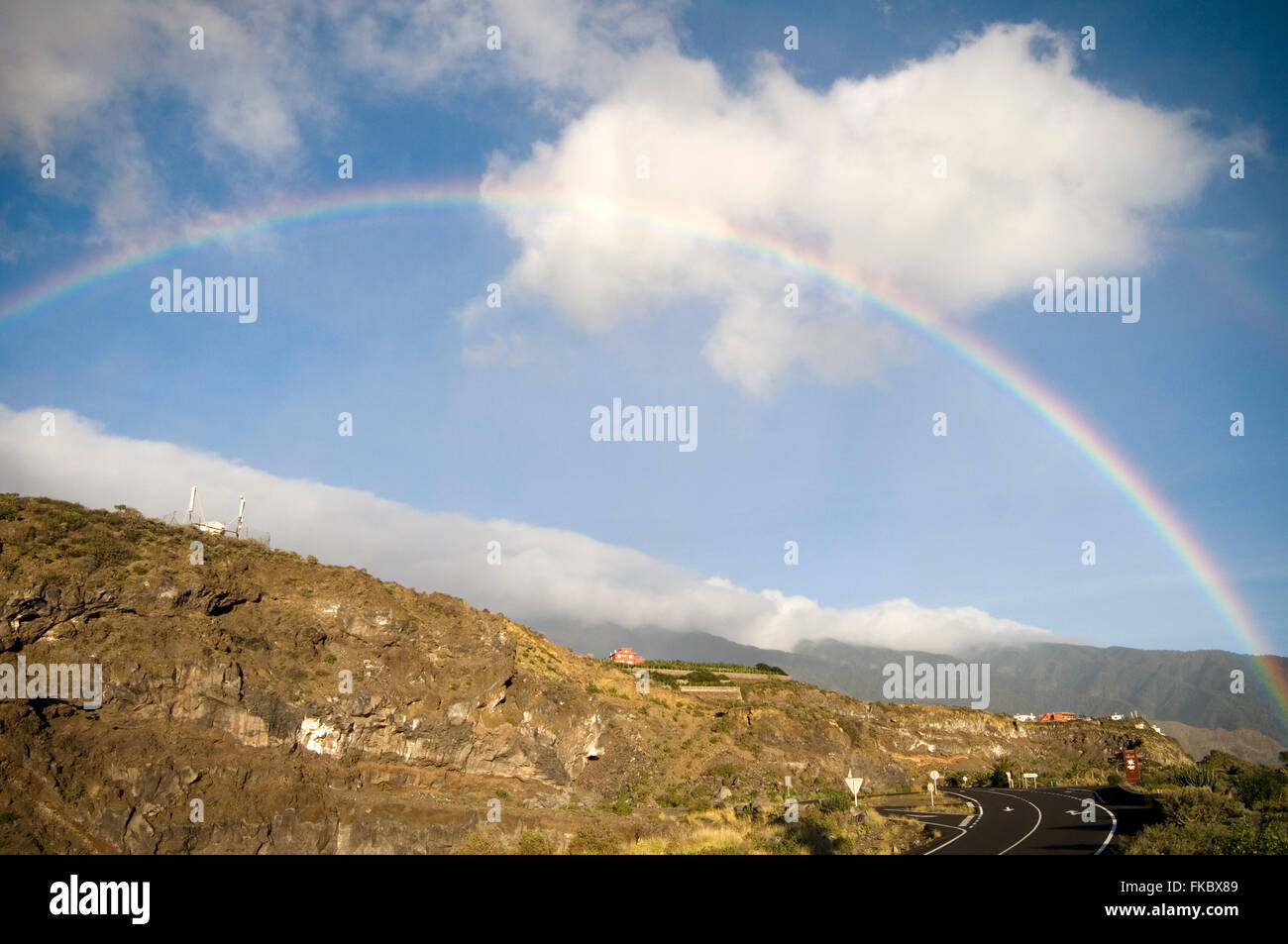 rainbow rainbows water refraction retracted light index complete arch arches light splitting in to separate wavelengths - Stock Image