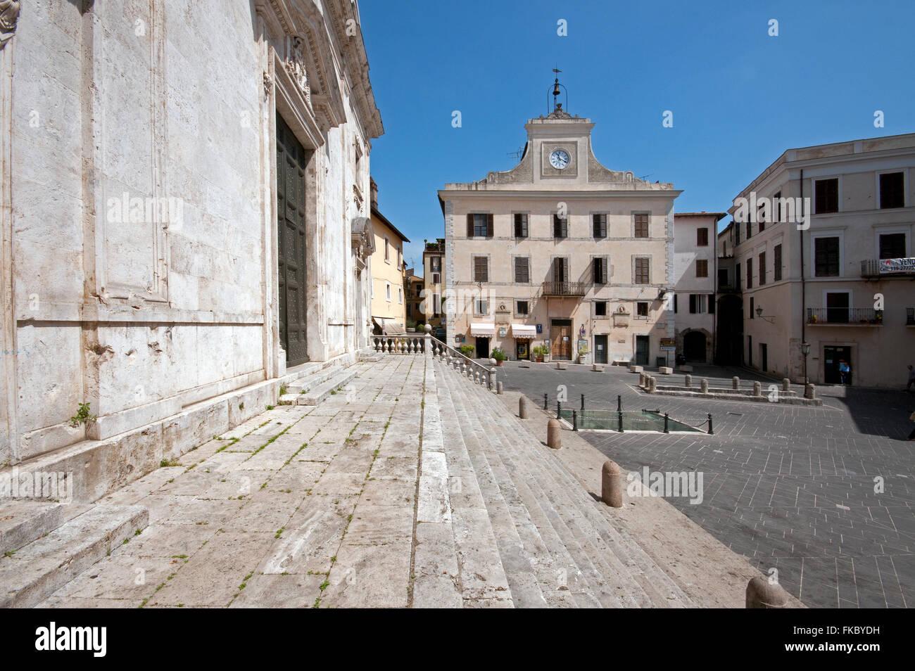 Orte, piazza della Libertà, on the left the Cathedral and in the background Palazzo dell'Orologio (Clock - Stock Image