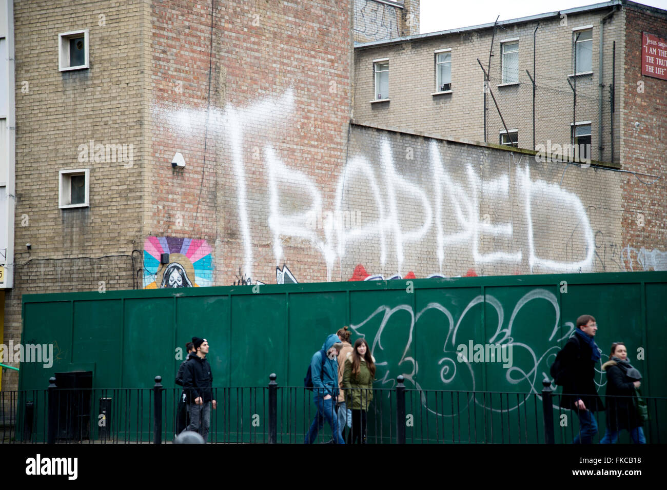 Bethnal Green. Writing on a wall, 'Trapped'. - Stock Image