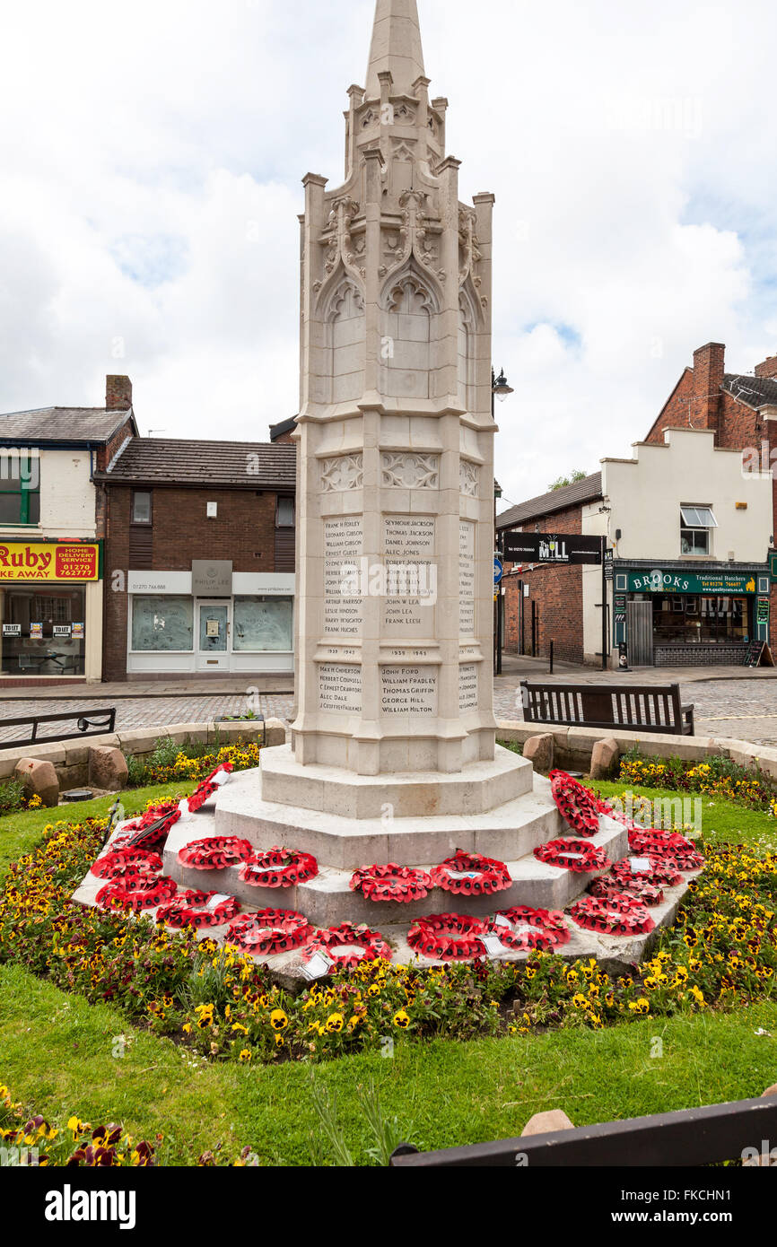 Poppy wreaths around the war memorial at Sandbach town centre Sandbach Cheshire England UK - Stock Image