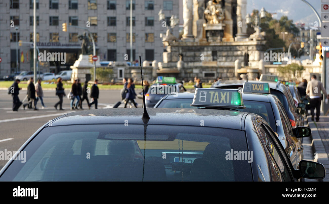 lined up taxi cabs at Placa Espagna in Barcelona - Stock Image