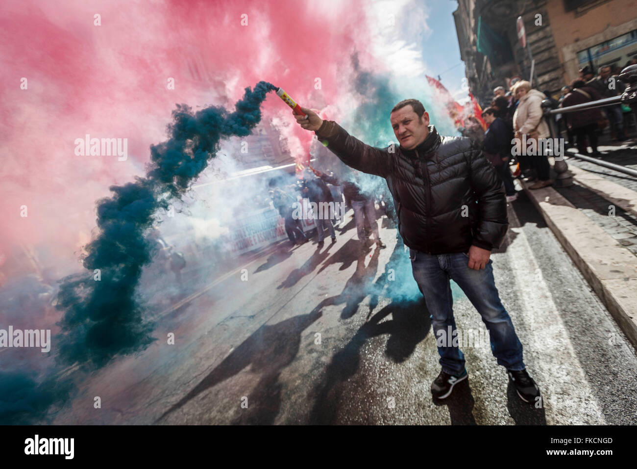 Rome, Italy. 08th Mar, 2016. School workers cleaning hold flares as they take part in a protest to claim the stabilization Stock Photo