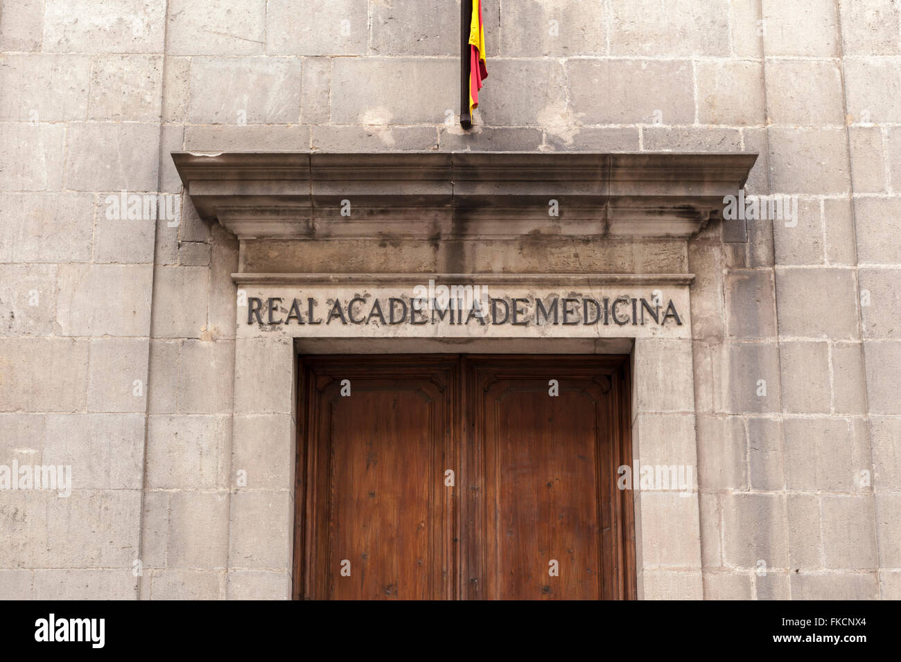 Ancient Hospital de la Santa Creu, door sign Real Academia de Medicina,El Raval, Barcelona. Stock Photo