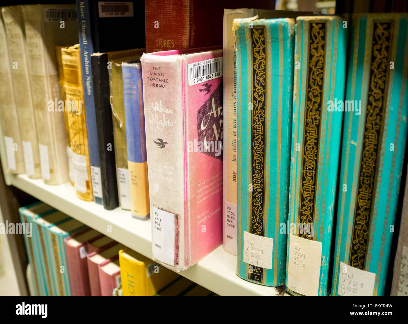 A library bookshelf of old Arabian Nights (One Thousand and One Nights) books. - Stock Image
