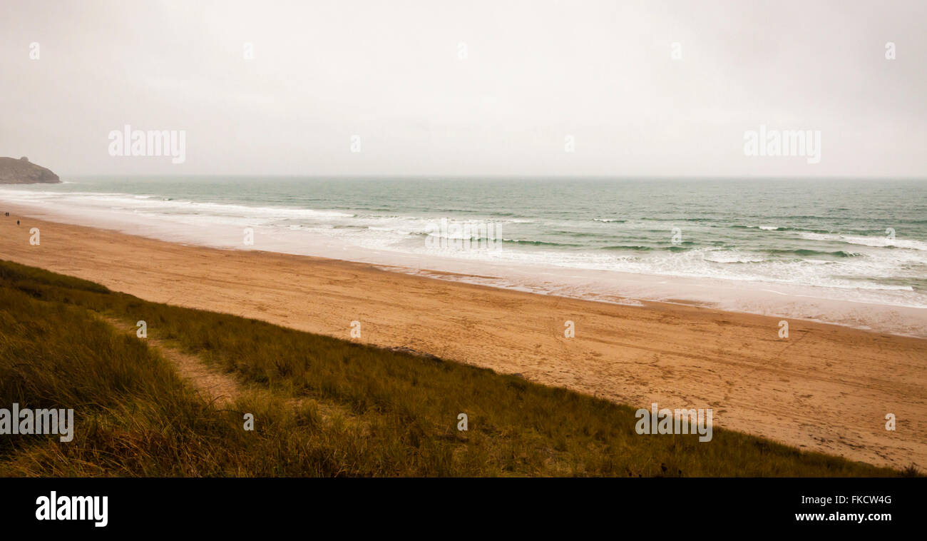 Almost deserted beach on a stormy day in Cornwall, UK. - Stock Image