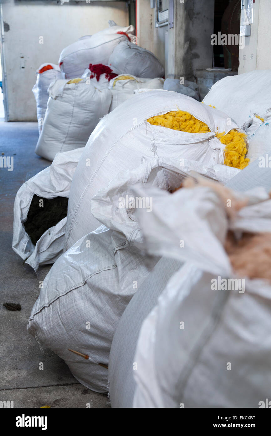 Bags of dyed wool used in Harris tweed production at Shawbost Mill, Isle of Lewis. September 2015 - Stock Image