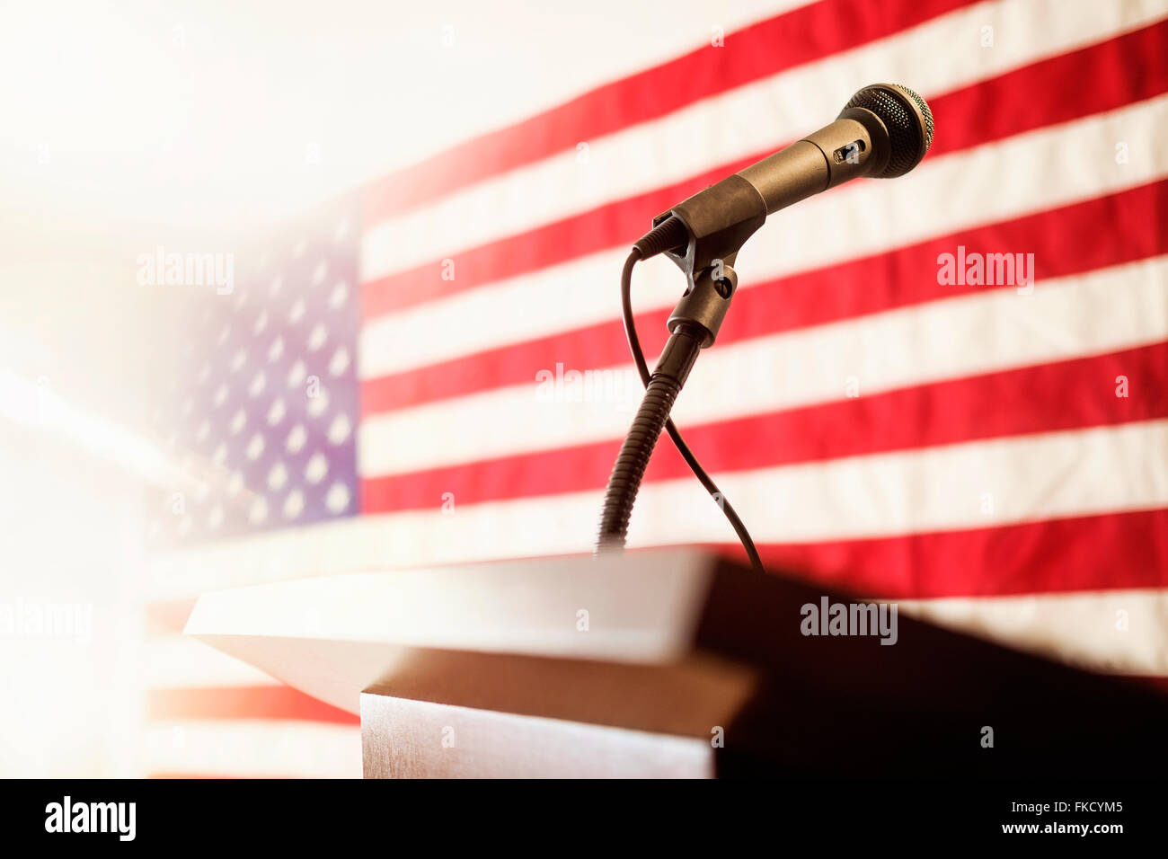 Lectern with American flag in background - Stock Image