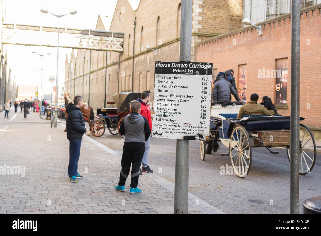 Horse drawn carriages picking up tourists outside the Guinness Storehouse, Dublin, Ireland - Stock Image