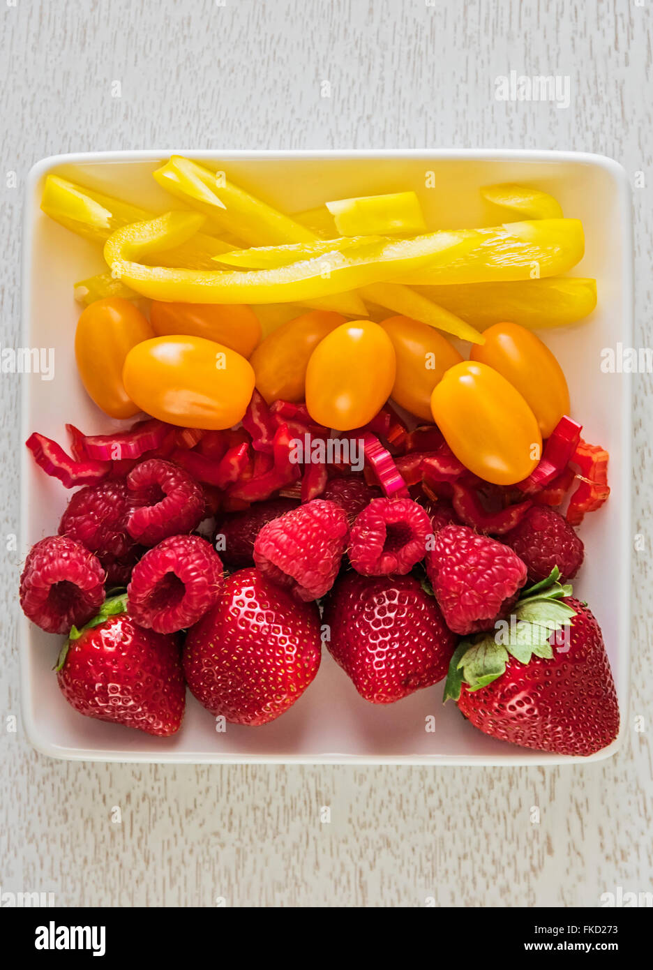 Fruit and vegetables on plate - Stock Image