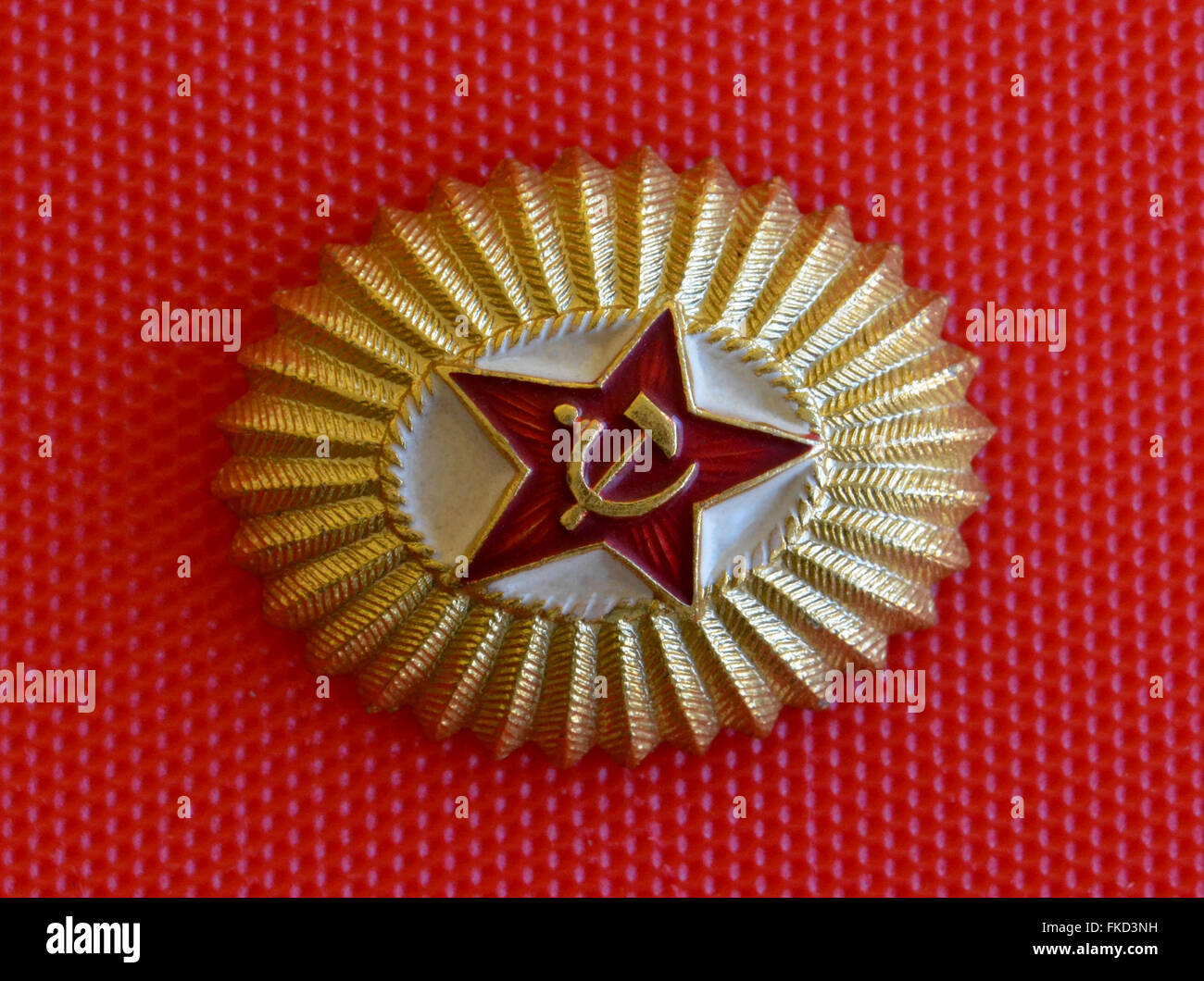 A popular badge of the Soviet Union shows a red star with the hammer and sickle, a Communist symbol created for Stock Photo