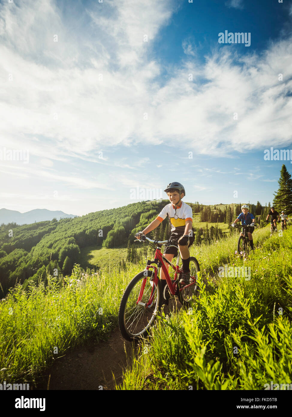 Parents with sons (10-11,12-13) during bike trip - Stock Image