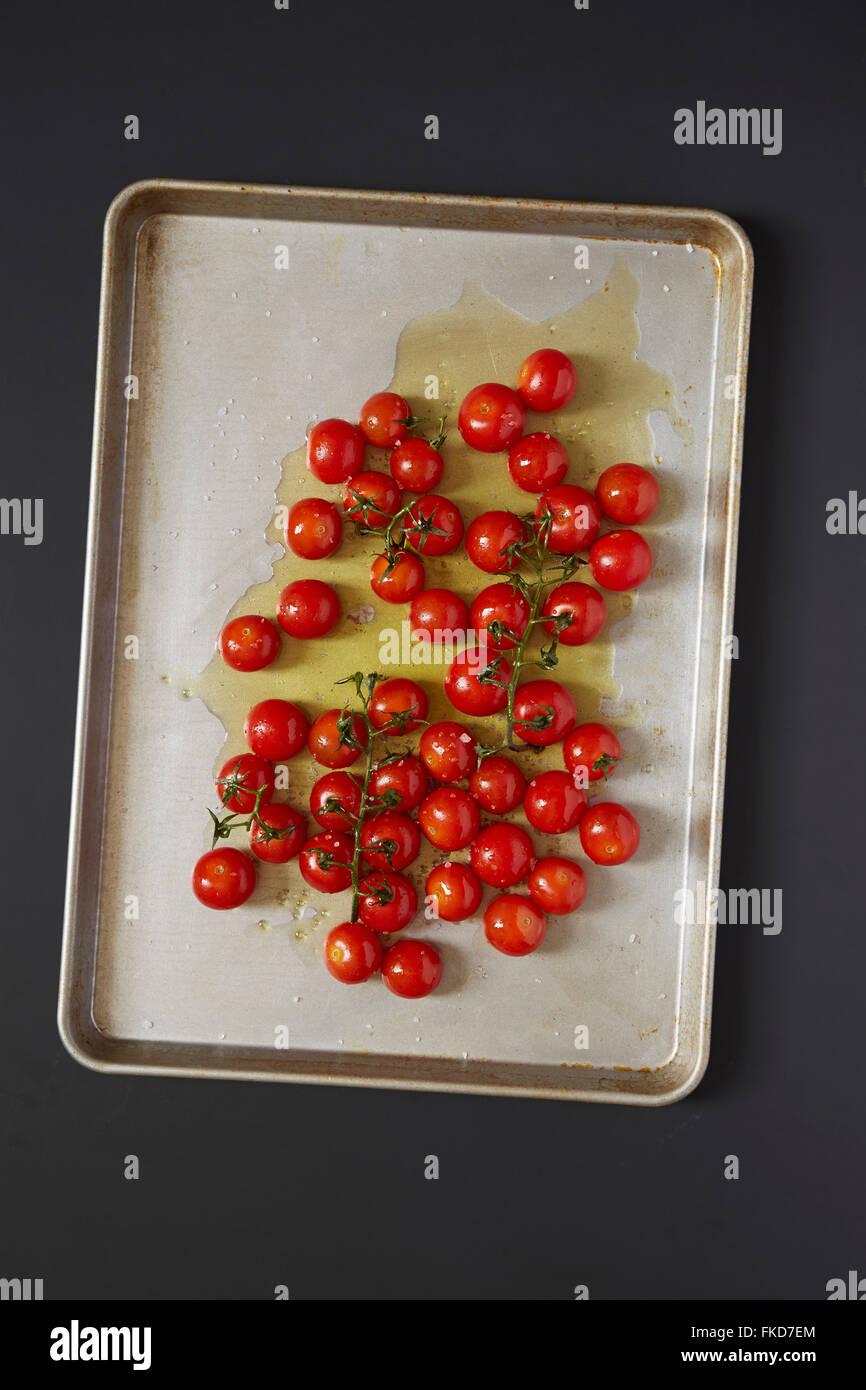 Cherry tomatoes on baking sheet - Stock Image
