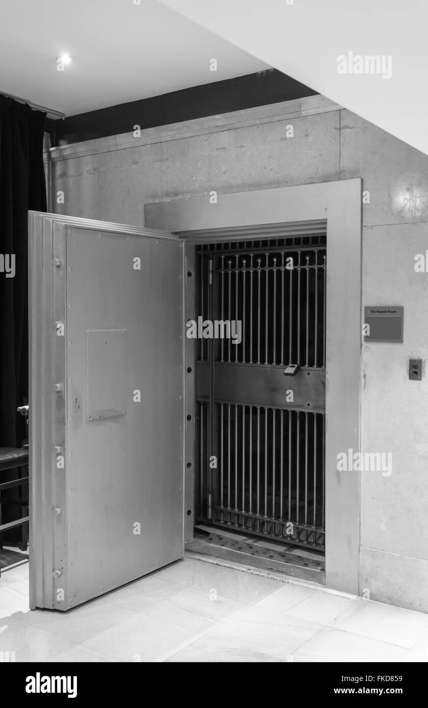 Bank vault with open door & closed grill with lock - Stock Image