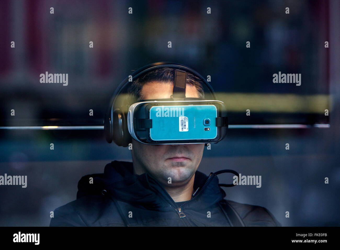 Man wearing headset virtual reality Samsung Gear, Prague, Czech Republic - Stock Image