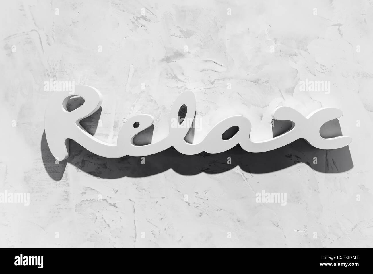 "The word ""RELAX"" written in wooden letterpress type. Stock Photo"