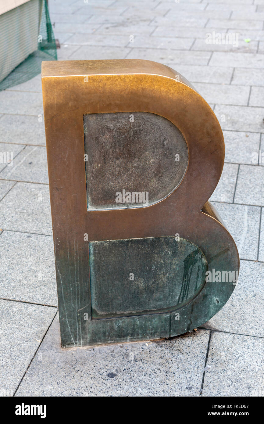 Urban art, 'Barcino', detail work, letter B of Barcino, by Joan Brossa, close to cathedral. Barcelona. - Stock Image