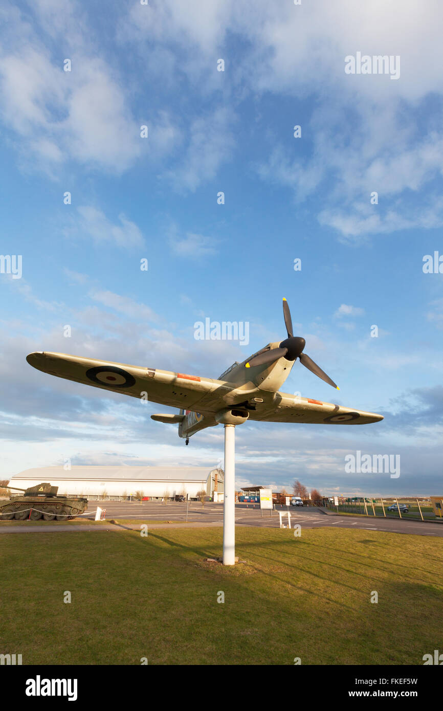 Replica Hawker Hurricane at the entrance to Duxford imperial War Museum, Duxford,  Cambridgeshire UK - Stock Image