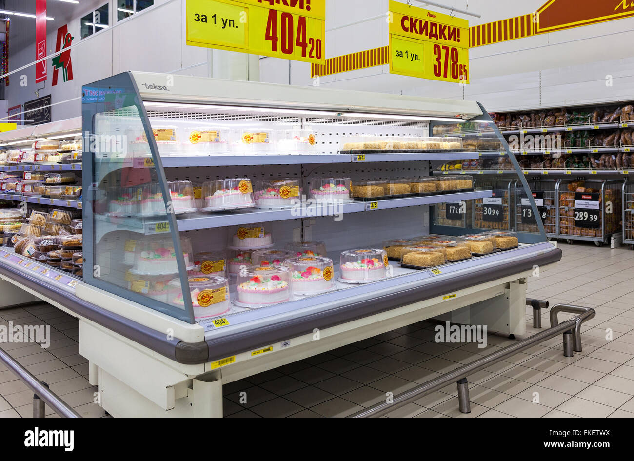 Showcase with sweet cakes ready to sale in hypermarket Auchan - Stock Image