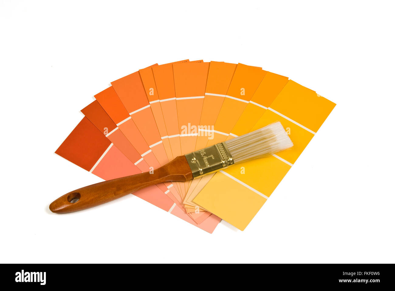 Paint Brush With Warm Tone Paint Samples - Stock Image