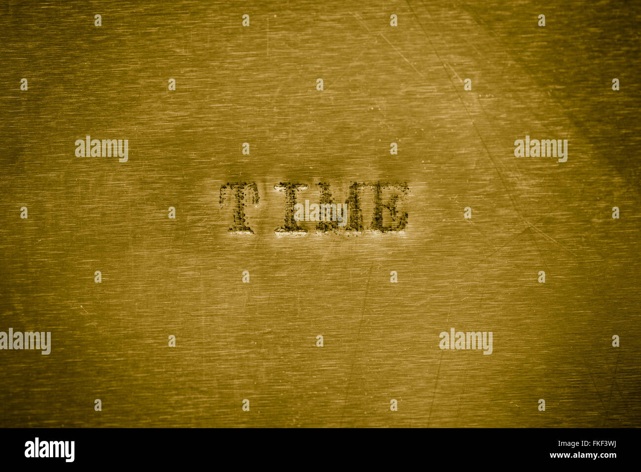 word time printed on  golden metallic background texture - Stock Image
