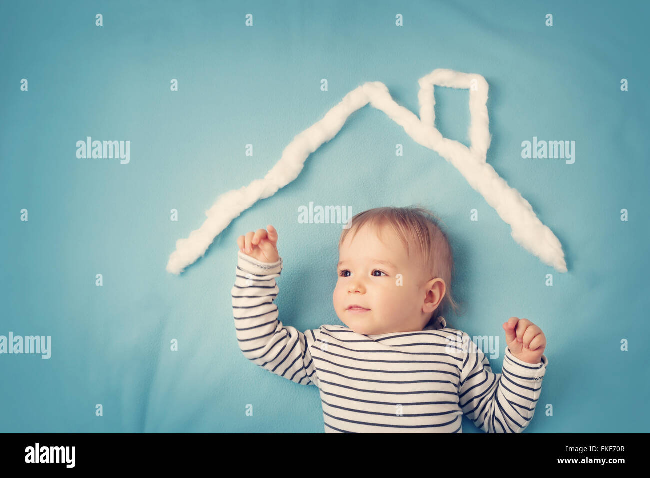 little boy with shape of house - Stock Image