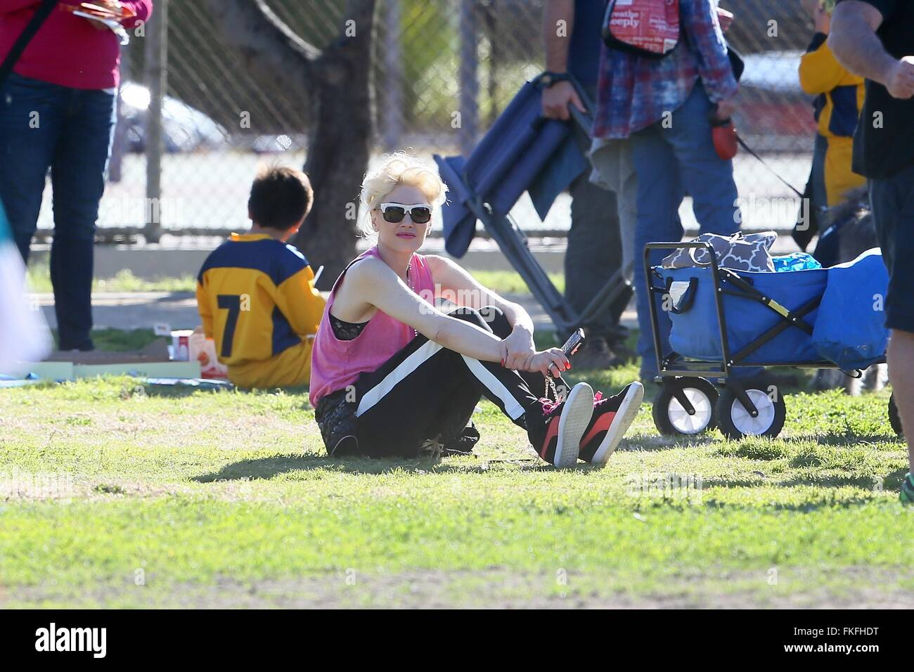 Gwen Stefani watches her son Zuma Rossdale play flag football at the park. Her two other sons, Kingston and Apollo, - Stock Image
