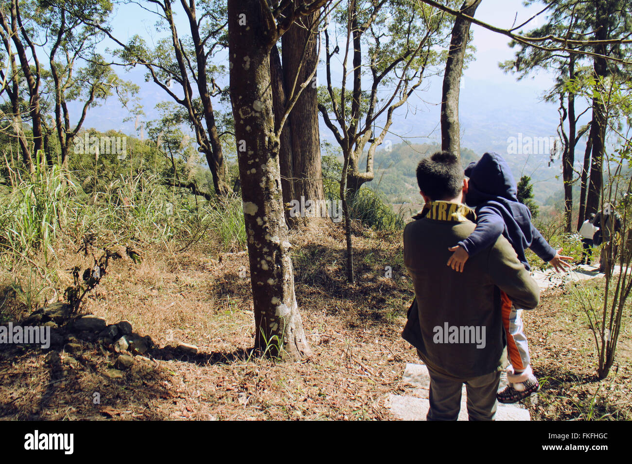 Father holding daughter - Stock Image