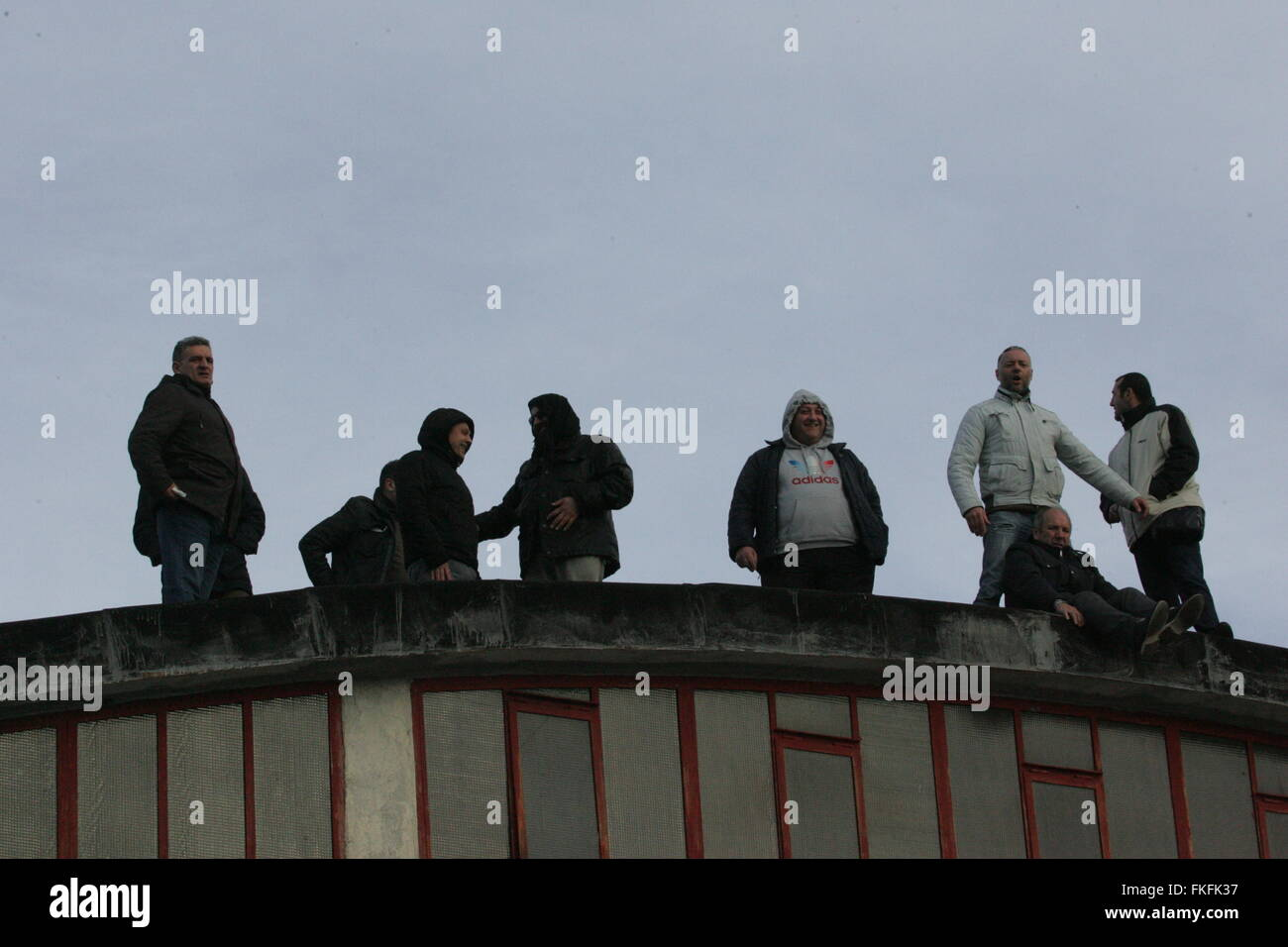 Arzano, Italy. 08th Mar, 2016. Drivers climb on rooftop and threat to not come down until they will not get a meeting Stock Photo