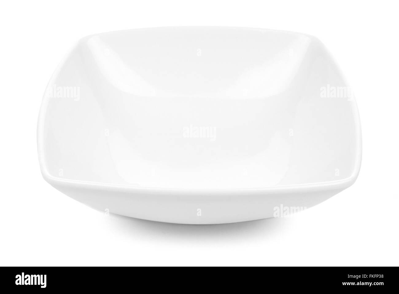 White rounded square bowl isolated on a white background - Stock Image