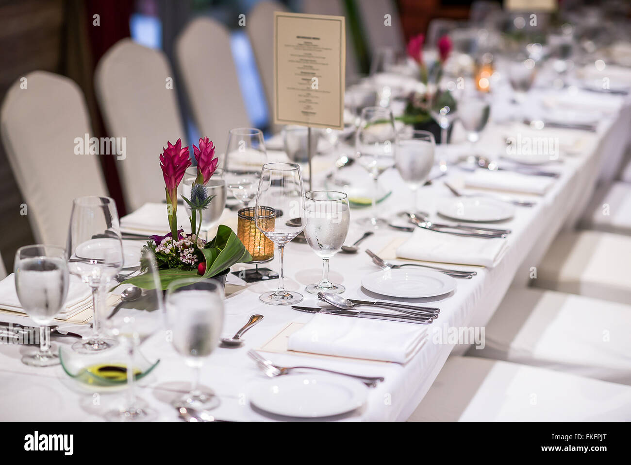 Luxurious table set up with plates and cutlery for dinner reception. & Luxurious table set up with plates and cutlery for dinner reception ...