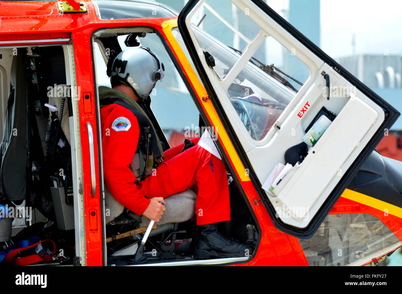 AUCKLAND - JAN 31 2016:Rescue Helicopter pilot sit in the cockpit. The median yearly income for a helicopter pilot - Stock Image