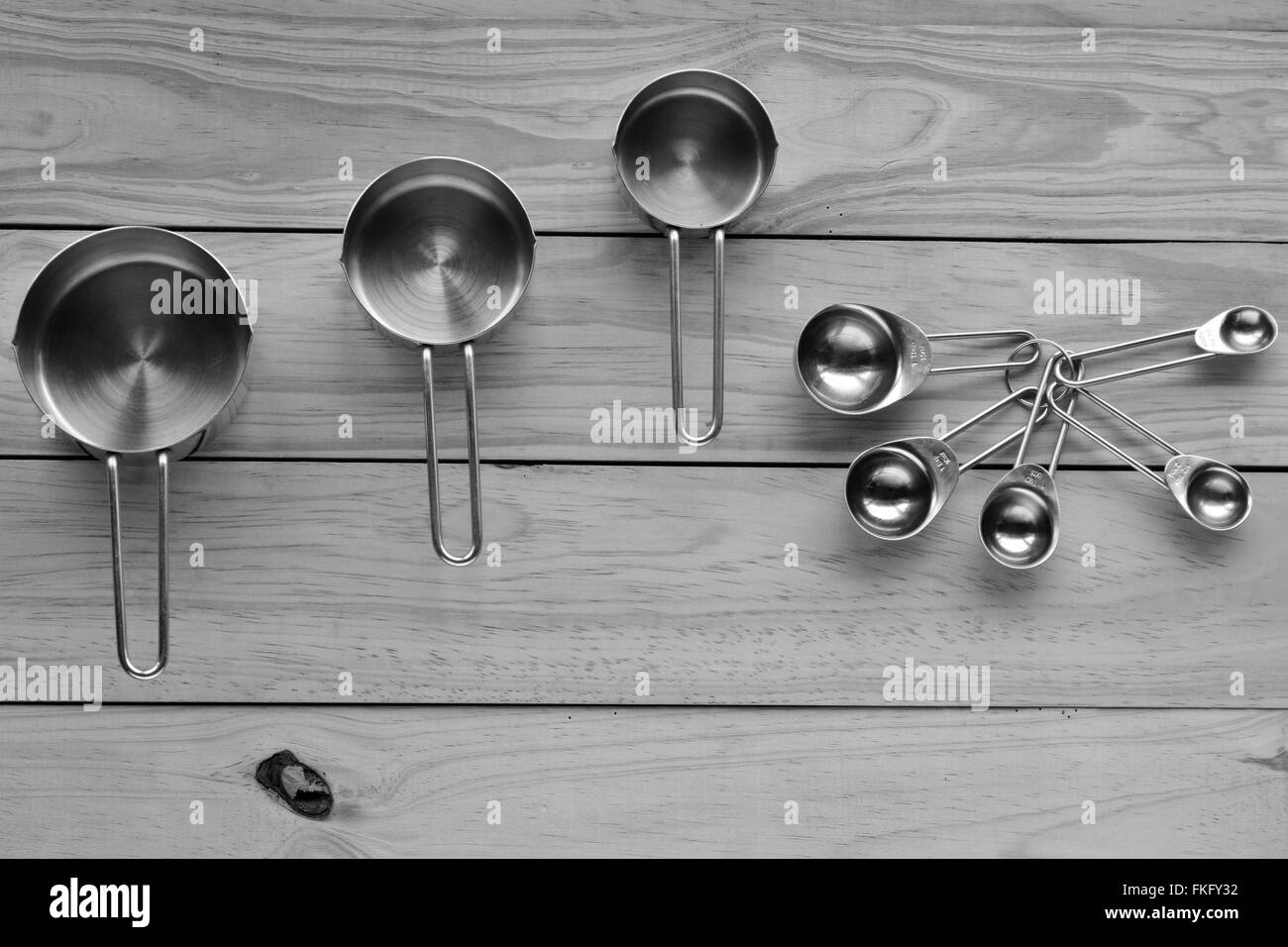Flat lay of stainless steel measuring cups and stainless steel measuring spoon set. Cooking concept - Stock Image